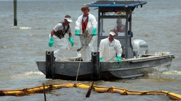 Crews work to clean up after the 2010 BP oil spill.