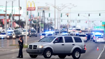 Police respond to the scene where three officers were shot and killed.