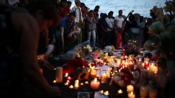 Mourners gather to remember victims in Nice, France, terror attack.