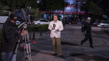 A Turkish journalist reports for TV.