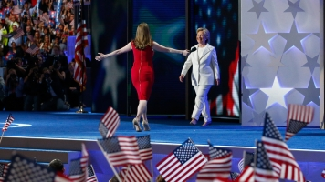 Chelsea Clinton gives her mom a hug onstage at the Democratic National Convention.