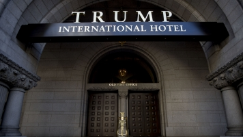 Artist Projects 'Pay Trump Bribes Here' On Trump International Hotel