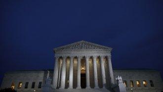 Supreme Court building at dusk