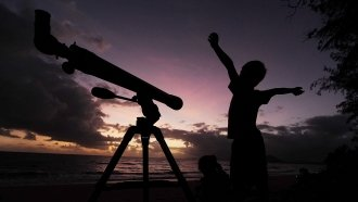 A young boy gets ready to view the solar eclipse with his telescope on November 14, 2012 in Palm Cove, Australia.
