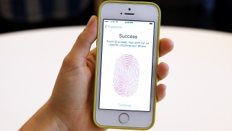 A person sets up a biometric lock on their phone
