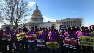 Federal workers protesting partial government shutdown