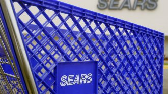 A Sears shopping cart is seen outside its store.
