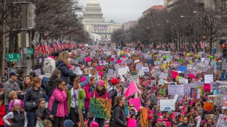 Demonstrators marching during the 2017 Women's March in Washington D.C.