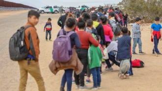 Migrants being processed by Customs and Border Protection