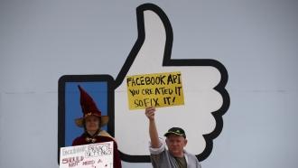 Protestors demonstrate outside of Facebook's Menlo Park location in April 2018