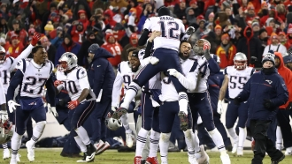 Tom Brady #12 of the New England Patriots celebrates with teammates.