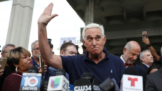 Roger Stone talking to the press