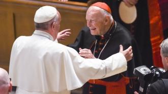 Cardinal Archbishop emeritus Theodore McCarrick greets Pope Francis