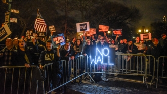 A group protesting President Donald Trump's declaration of a National Emergency