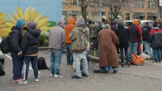 Homeless line up outside the Northern Kentucky Emergency Shelter in Covington, KY.