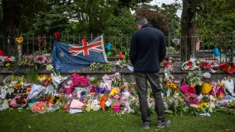 A man pays tribute to victims of Christchurch mosque attack