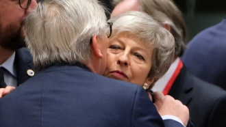 European Commission President Jean-Claude Juncker greets British Prime Minister Theresa May