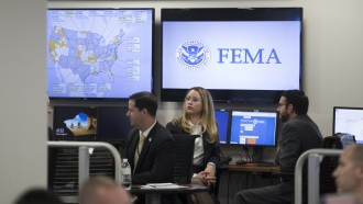 FEMA employees sitting in front of computer monitors