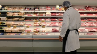 Meat is displayed in a case at a grocery store