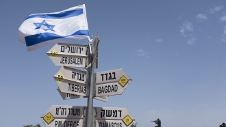 Sign in front of Golan Heights sculpture
