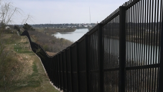 A border fence is seen along the U.S.-Mexico border