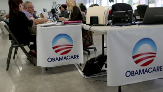 Obamacare logos on tables