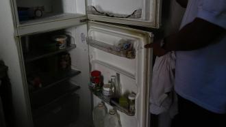 Man shows his powerless fridge