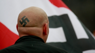 Neo-Nazis protest outside Skokie Holocaust museum dedication.