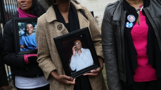Mothers hold pictures of children they lost to gun violence