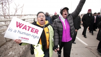 People participating in a march to highlight the push for clean water in Flint