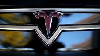A Tesla logo on a car