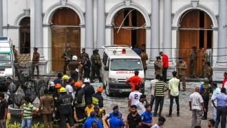 Sri Lankan security forces secure the area around St. Anthony's Shrine.