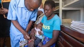 A child is given the malaria vaccine