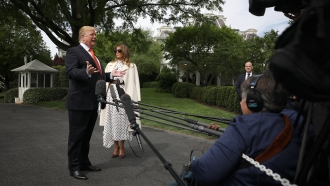 President Donald Trump and First Lady Melania Trump talk to reporters.