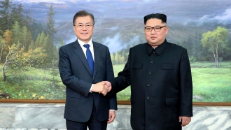 South Korean President Moon Jae-in shaking hands with North Korean leader Kim Jong-un