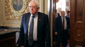 Democratic presidential candidate Sen. Bernie Sanders walks through the Senate Reception Room at the U.S. Capitol