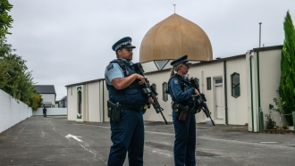 Police officers stand guard outside the Al Noor mosque in Christchurch, New Zealand
