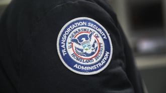 A TSA badge on an employee's uniform