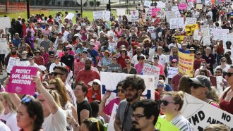 Protesters participate in a rally against one of the nation's most restrictive bans on abortions.