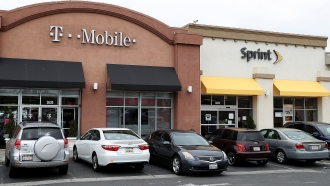 T-Mobile and Sprint store sit side-by-side in a strip mall