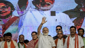 Indian Prime Minister Narendra Modi waves during a public rally