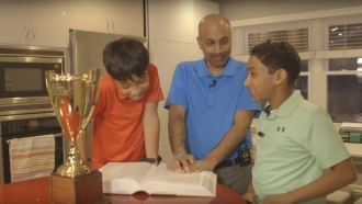 1985 Spelling Bee champion Balu Natarajan reads the dictionary with his sons