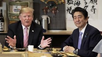 U.S. President Donald Trump speaks as Japanese Prime Minister Abe Shinzō looks on