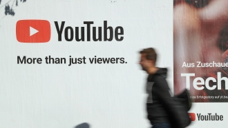 A man walks past a YouTube advertisement in Berlin, Germany in October of 2018