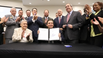 Florida Gov. Ron DeSantis signs the sanctuary city ban into law