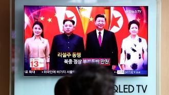 A TV broadcast of Kim Jong-un and Xi Jinping
