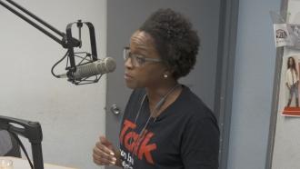 Deja Abdul-Haqq discussing HIV/AIDS on the radio in Jackson, Mississippi