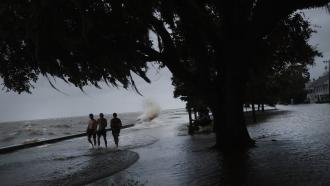 People walking through flood waters in Louisiana