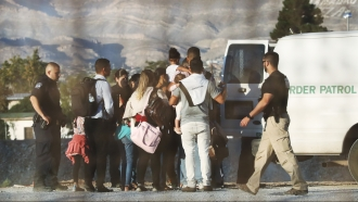 Border patrol with group of migrants