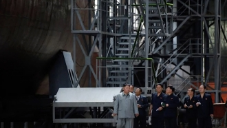 Kim Jong-un appears to inspect a submarine.
